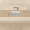 Casablanca Limestone washstand, wall panel and mosaic tiles.