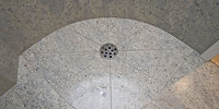Kashmir White shower with floor drain.