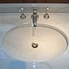 Detail of selected light-coloured Bianco Carrara Typ C washstand counter top, polished.